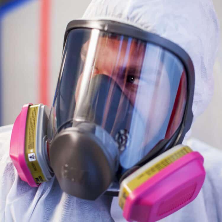 1-800 Water Damage technician in hazmat mask