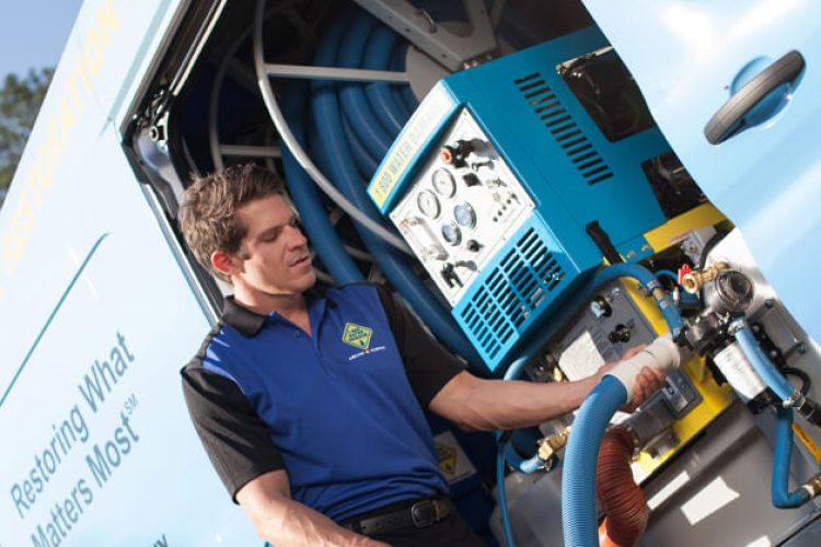 1-800 Water Damage technician at van